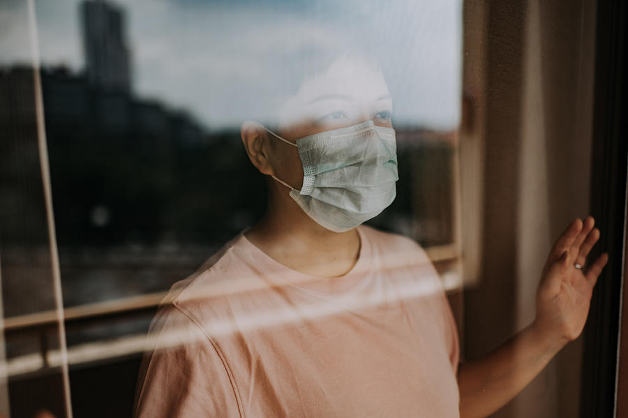 An Asian Chinese Female Looking Thru Her Balcony Window With Her Face Mask During The Restricted Movement Order In Malaysia Photograph by Chee Gin Tan