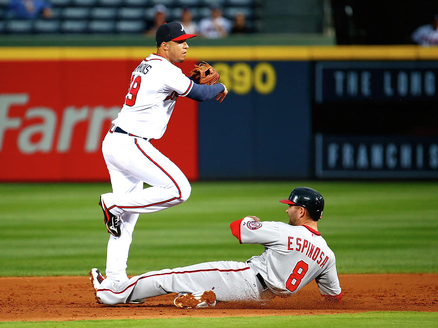Andrelton Simmons And Danny Espinosa Photograph by Kevin C. Cox