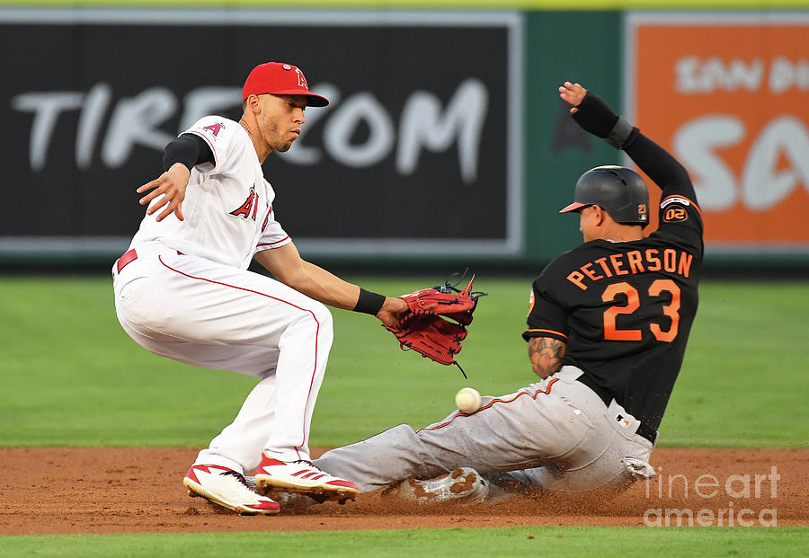 Andrelton Simmons And Jace Peterson Photograph by Jayne Kamin-oncea