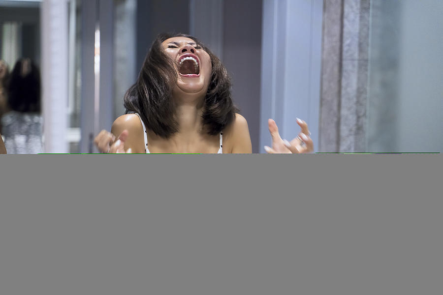 Angry woman shouting at mirror and crying Photograph by Enes Evren
