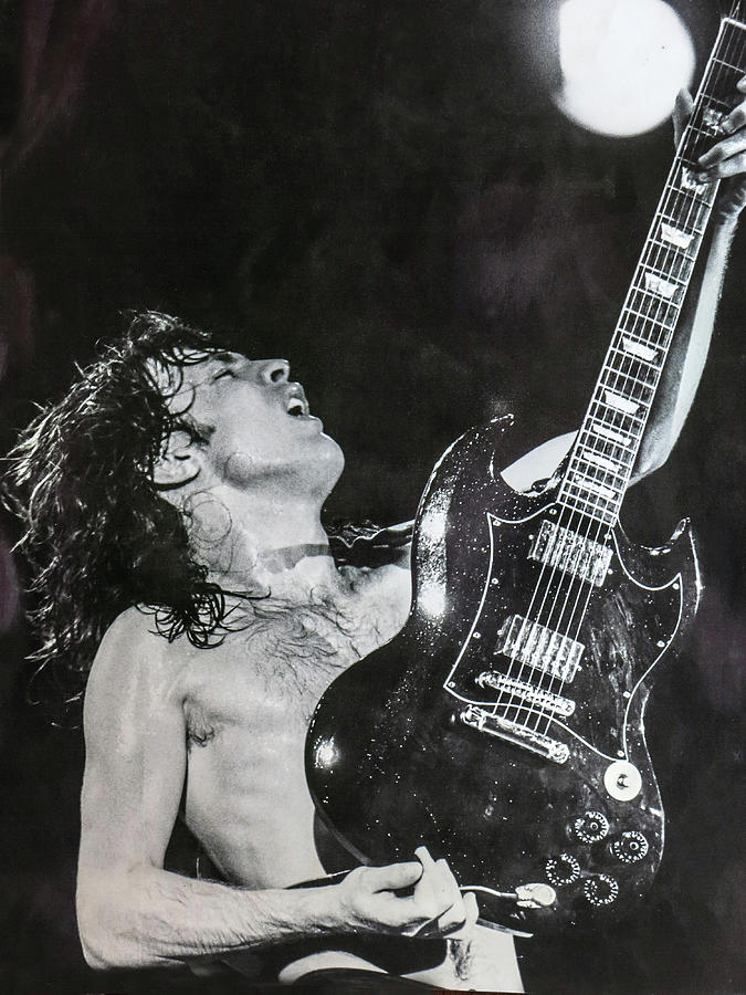 Angus Young Photograph - Angus Young 1981 ACDC by Leigh Henningham