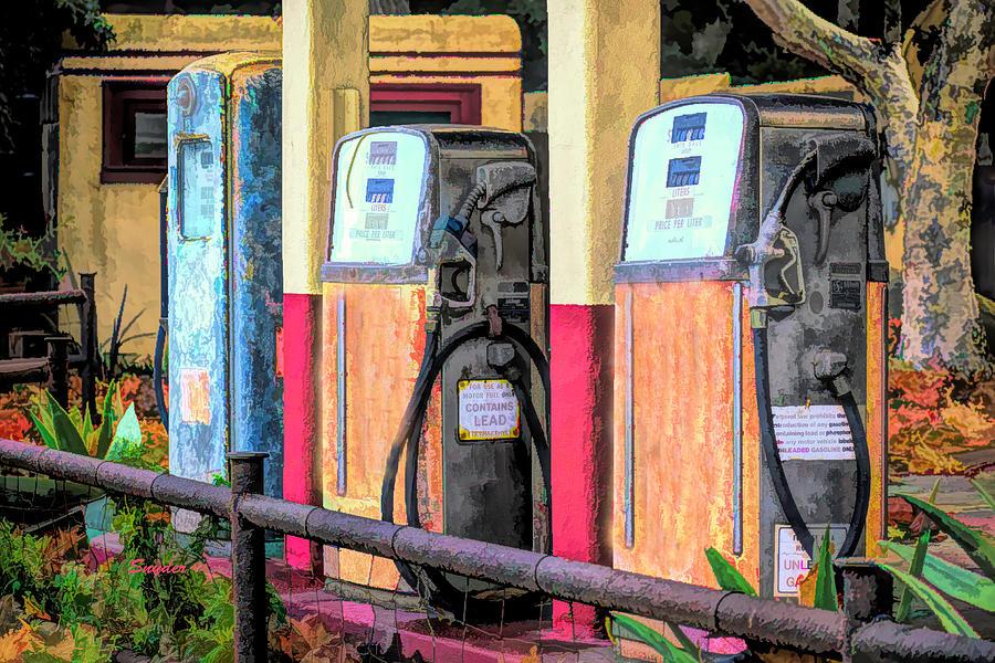 Antique Gas Pumps At The Station Photograph