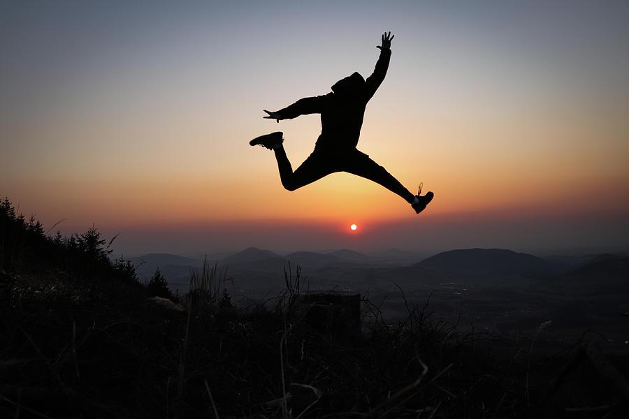 Athlete Jump Over Sun Photograph