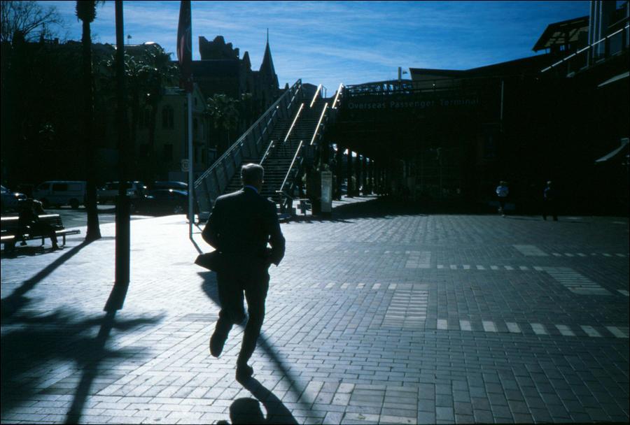 Australia, Sydney, Man Running Across City Square Photograph by Willie Schumann / EyeEm