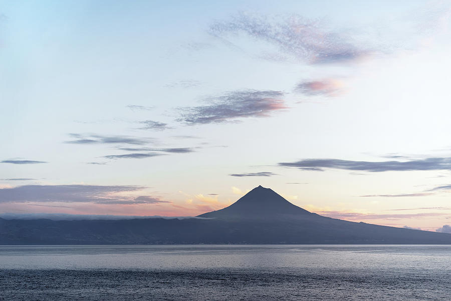View Photograph - Azores - View over water to the volcano Pico in the evening ligh by Ralf Lehmann
