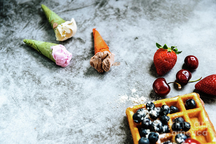 Background of foods refreshing ice cream in cones with red fruit by Joaquin Corbalan