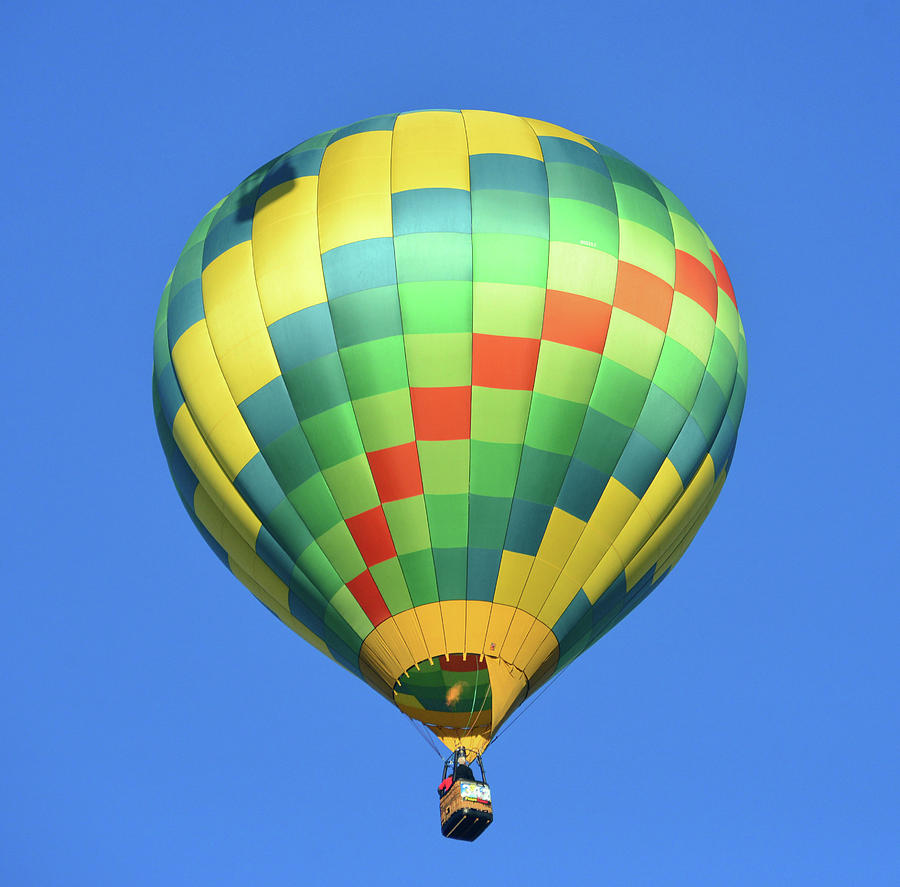 Balloon in the blue sky by David Lee Thompson