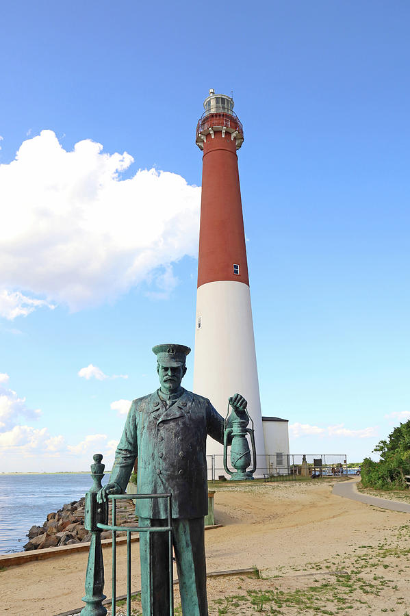 Barnegat Lighthouse And The Lighthouse Keeper Statue Photograph