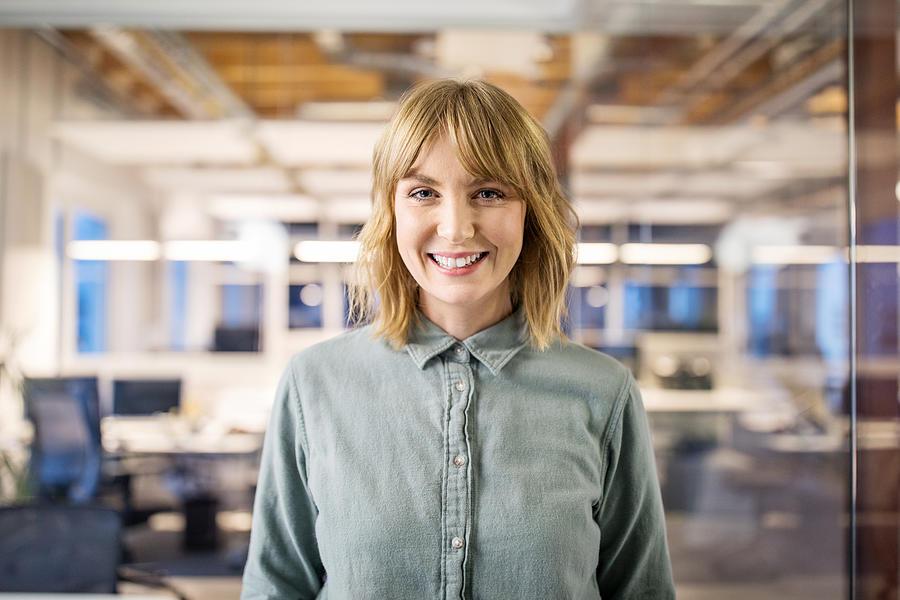 Beautiful businesswoman standing in modern office. Photograph by Luis Alvarez