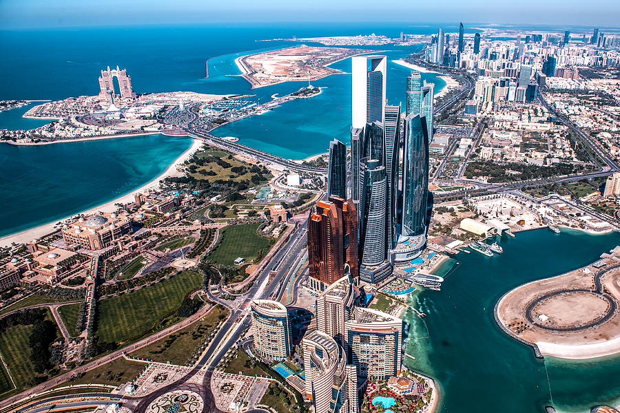 Beautiful high angle view of modern skyscrapers in Abu Dhabi, taken from a helicopter. Marina is also visible further back Photograph by Extreme-photographer