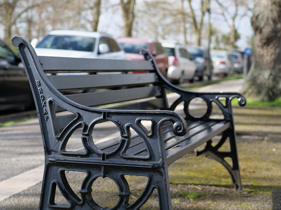Bench For People To Sit Along The Thames River Embankment In Windsor, Berkshire, England, Uk Photograph