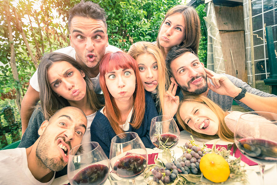 Best friends taking selfie outdoor at winery tasting wine Photograph by ViewApart
