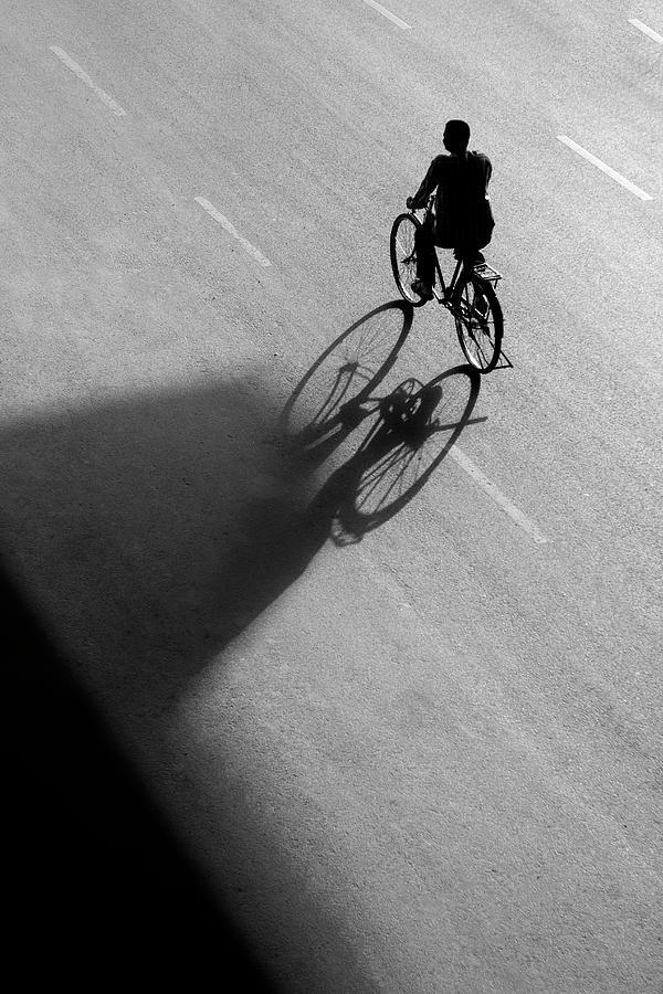 Minimalism Photograph - Bicycle Shadow Vs Shadow Triangle by Prakash Ghai