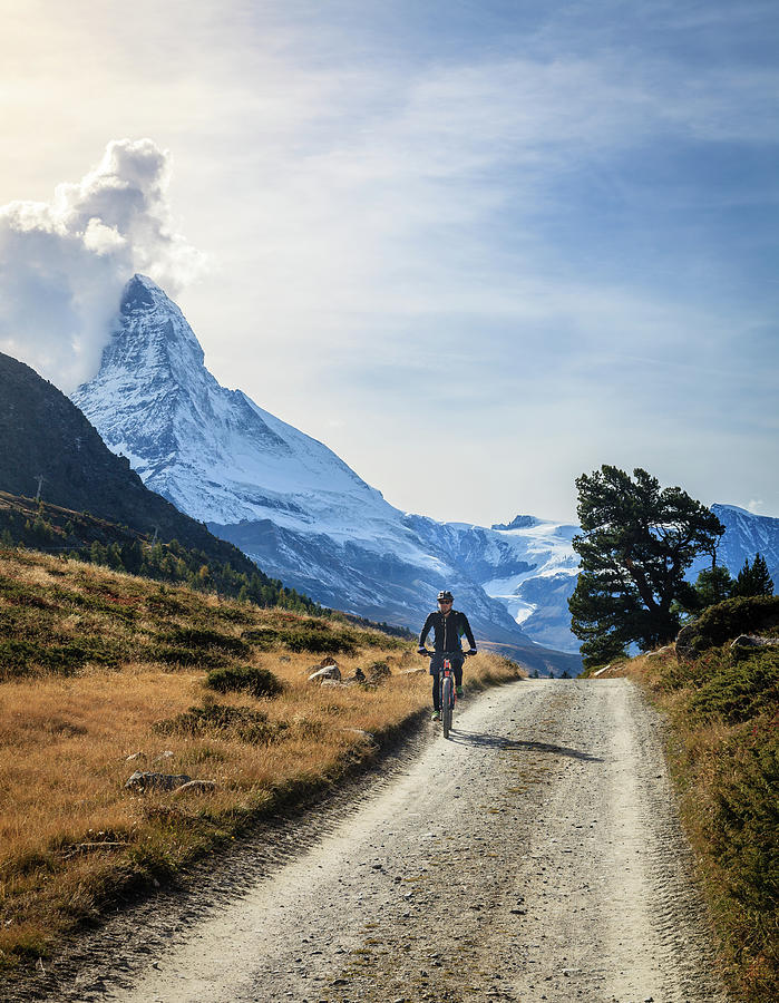 Bicycling In The Alps Photograph