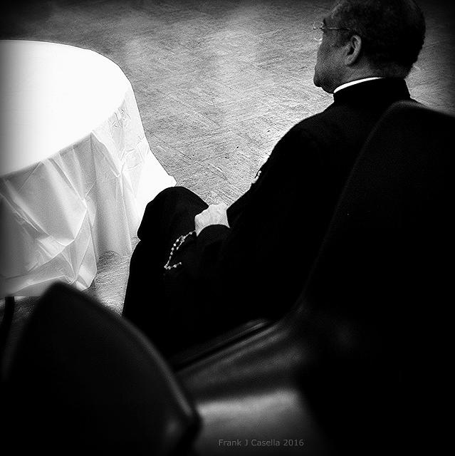 Documentary Photograph - Bishop Prays the Rosary by Frank J Casella