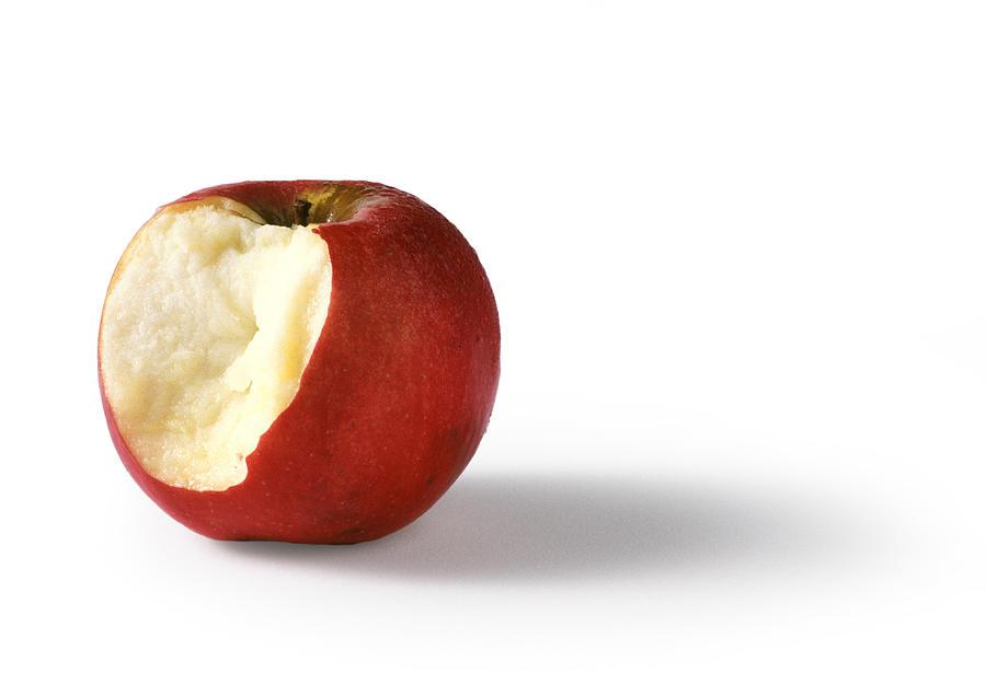 Bitten red apple, white background Photograph by Isabelle Rozenbaum