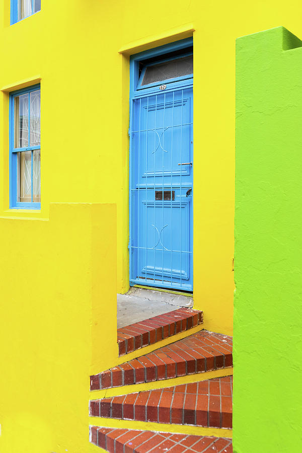 Blue Door Yellow House Photograph By Elvira Peretsman