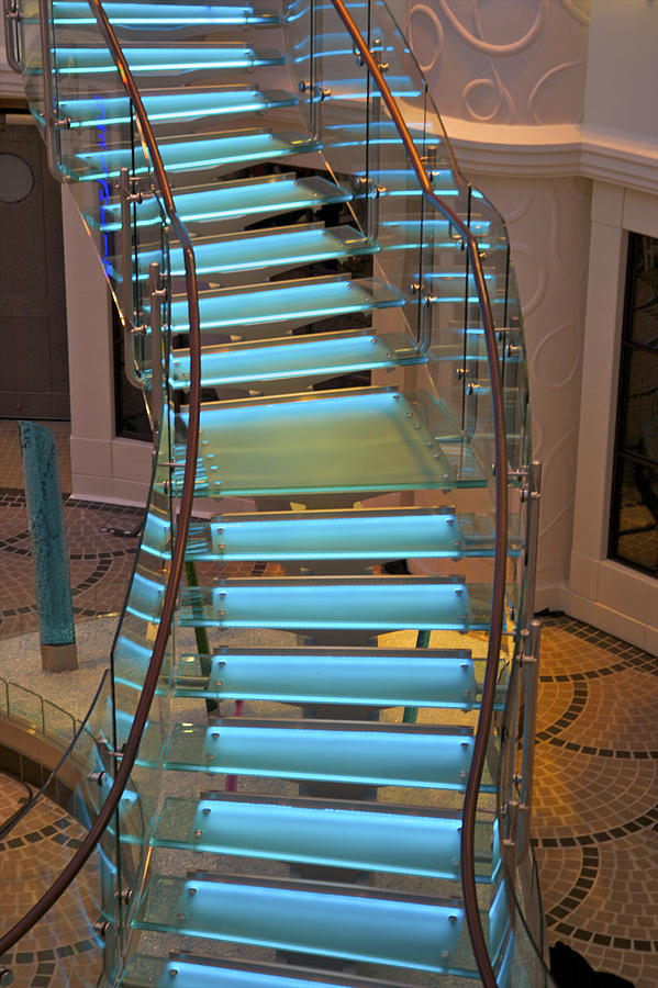 Blue-lit free-form staircase. Photograph by Barry Winiker