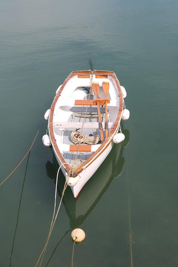 Boat And Buoys Photograph