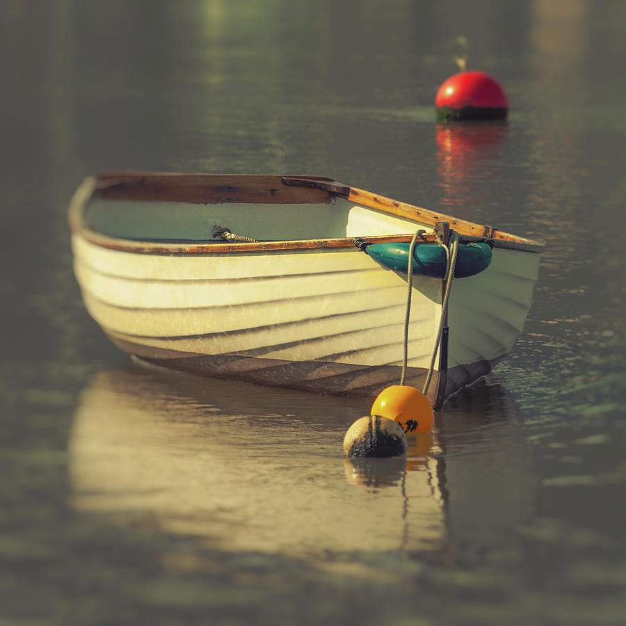 River Photograph - Boat in sunlight on calm water with reflection by A J Paul