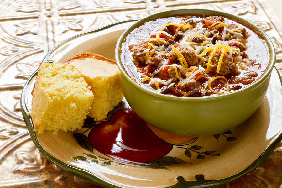 Bowl of Chili with Shredded Cheese and Corn bread Photograph by Grandriver
