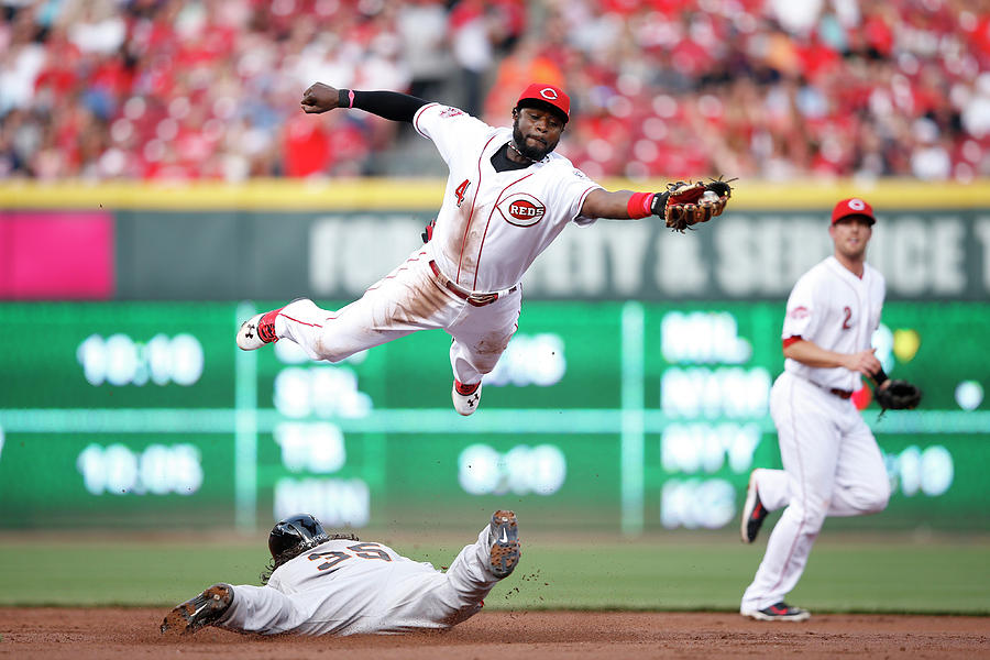 Brandon Crawford And Brandon Phillips Photograph by Joe Robbins