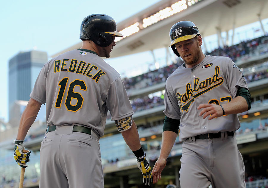 Brandon Moss And Josh Reddick Photograph by Hannah Foslien