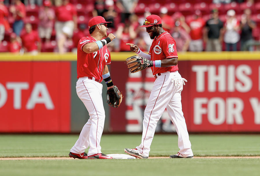 Brandon Phillips and Eugenio Suarez Photograph by Andy Lyons