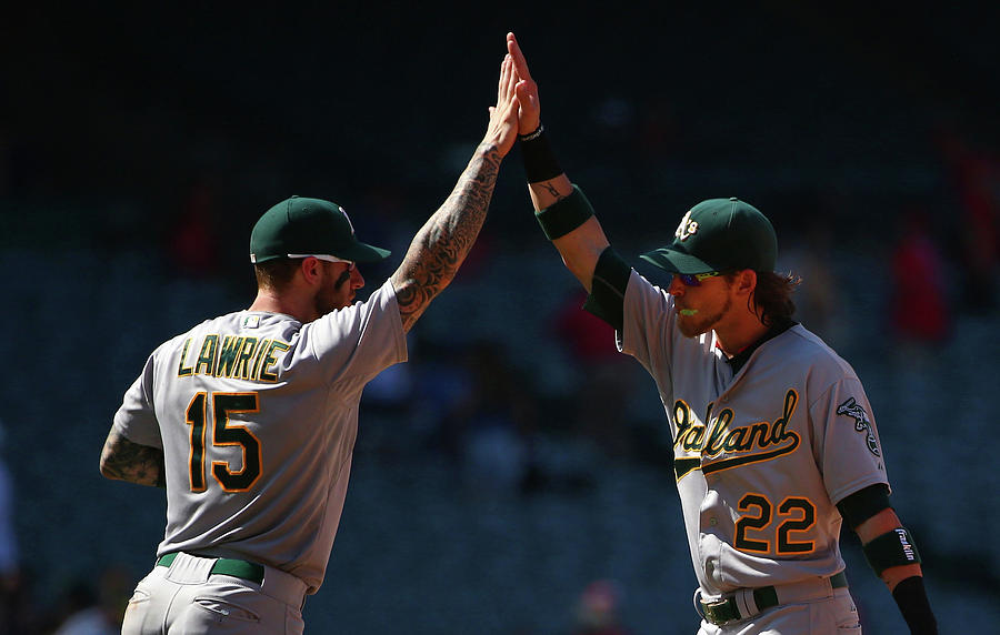 Brett Lawrie and Josh Reddick Photograph by Victor Decolongon