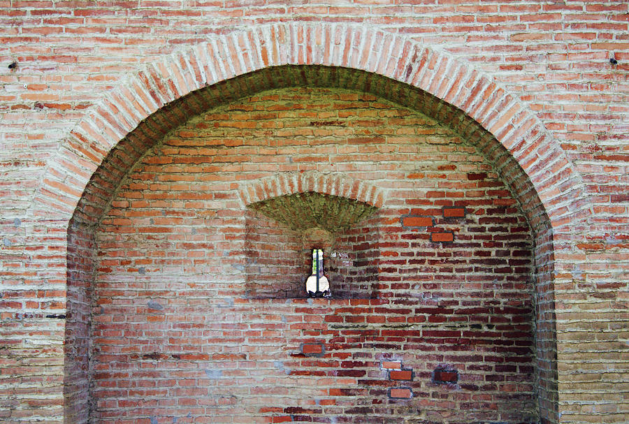 Brick Arch On Old Citadel Wall With A Keyhole Like Shape Window Photograph