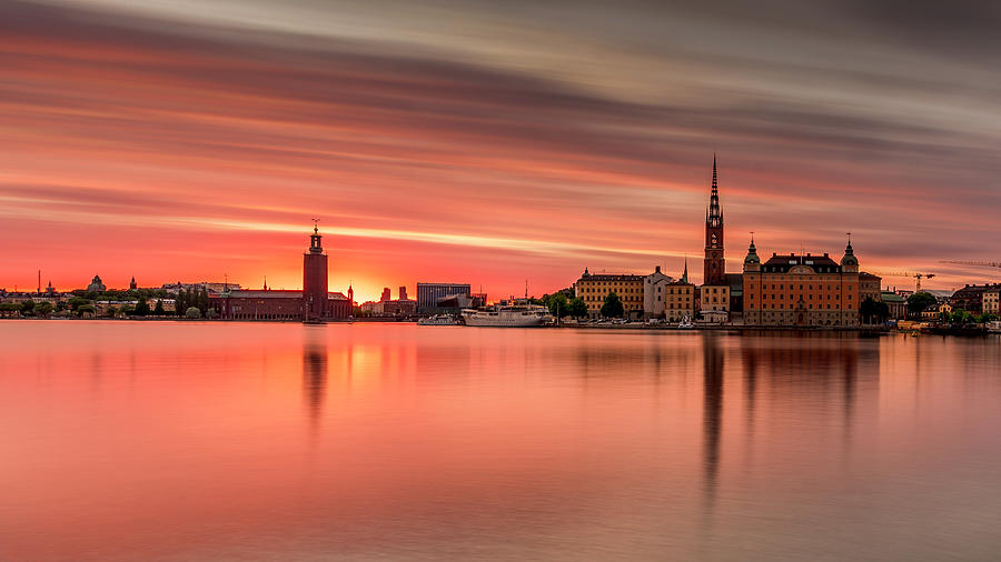 Fiery Photograph - Burning long exposure sunset over Stockholm by Dejan Kostic