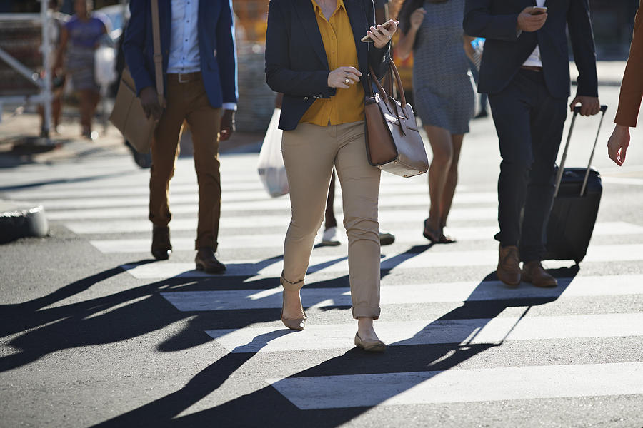Business people walking on pedestrian crossing Photograph by Klaus Vedfelt