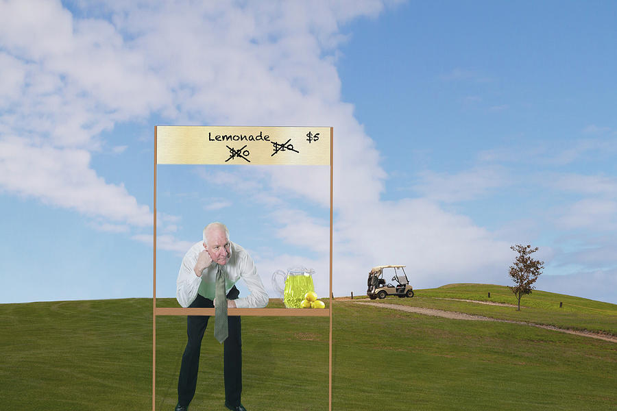 Businessman Selling Lemonade On Golf Course Photograph