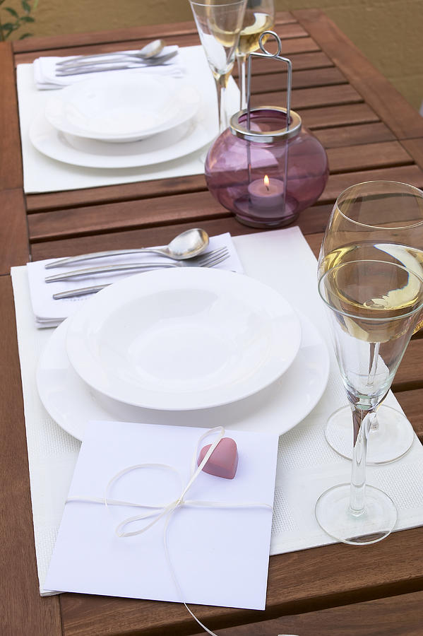 Card with heart on place setting, elevated view Photograph by Heidi Coppock-Beard