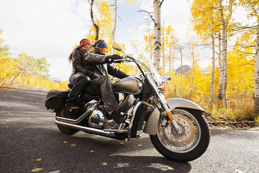 Caucasian couple riding motorcycle Photograph by Blend Images - Mike Kemp