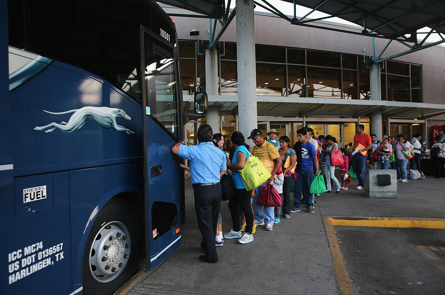 Central Americans Freed By Border Patrol Depart For Destinations Around The U.S. Photograph by John Moore