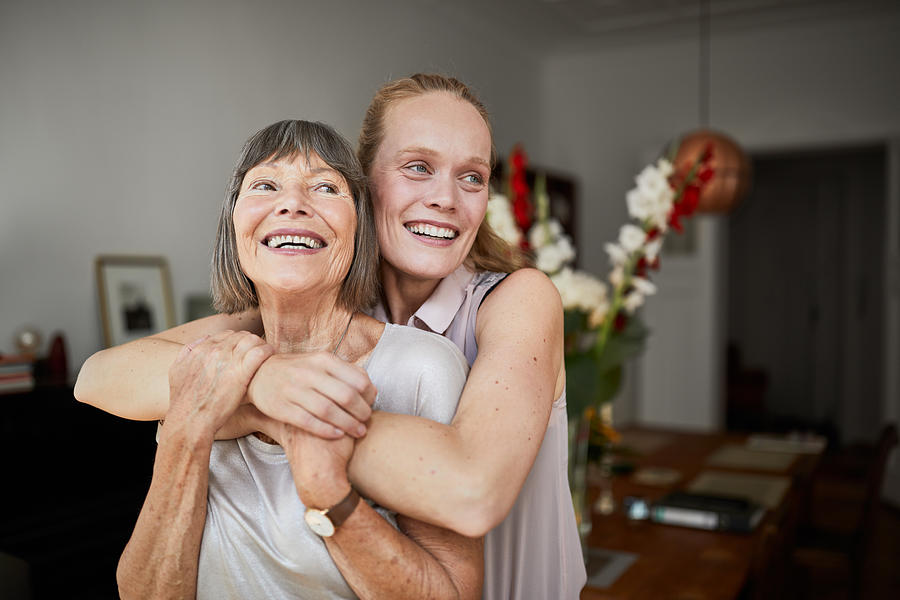 Cheerful mother and daughter at home Photograph by Luis Alvarez