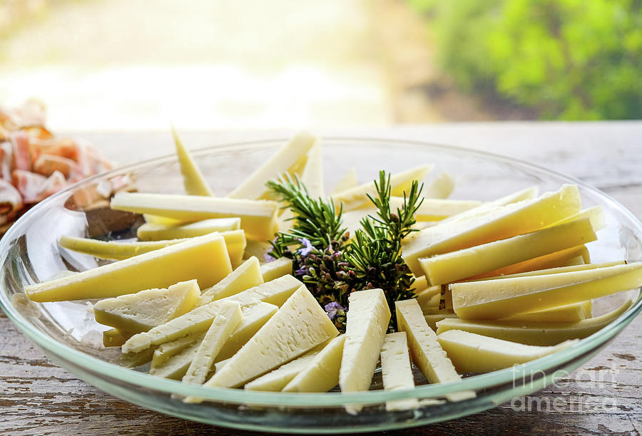 cheese wedges on a plate slices of pecorino by Luca Lorenzelli