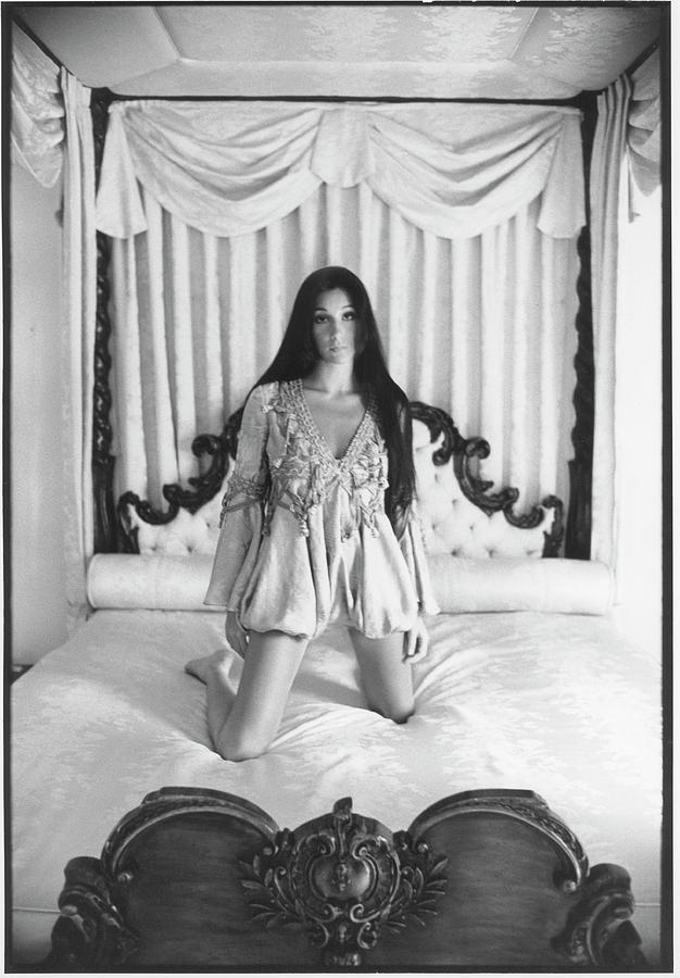 Cher On A Canopy Bed Photograph by Berry Berenson