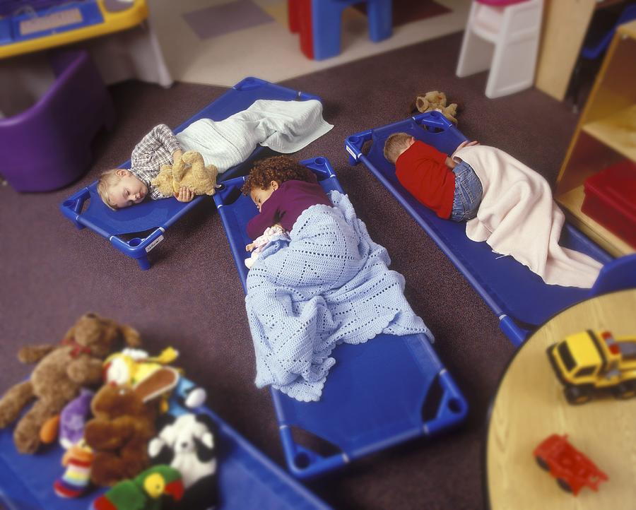 Children Napping On Floor Of Preschool Classroom Photograph by Ingram Publishing