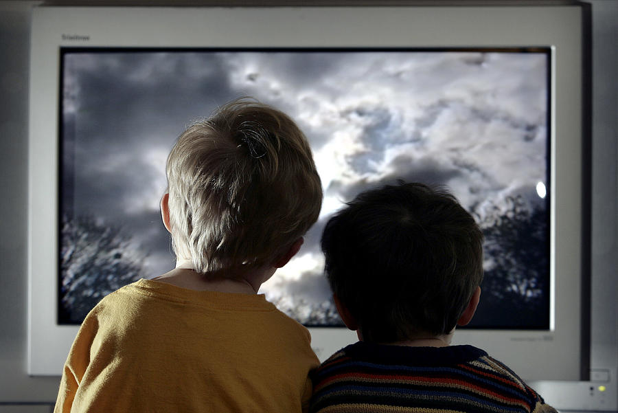 Children Watch Television At Home Photograph by Peter Macdiarmid