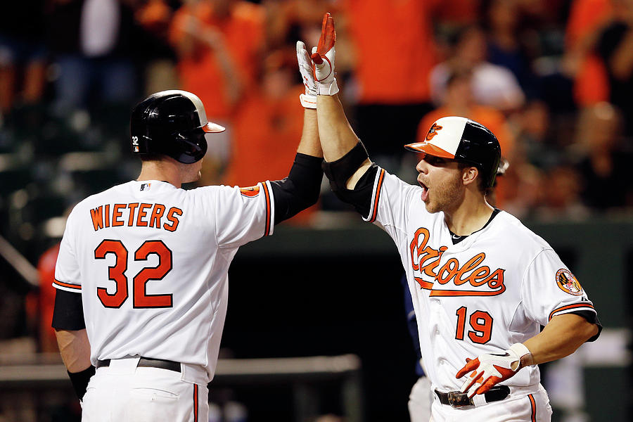 Chris Davis and Matt Wieters Photograph by Rob Carr