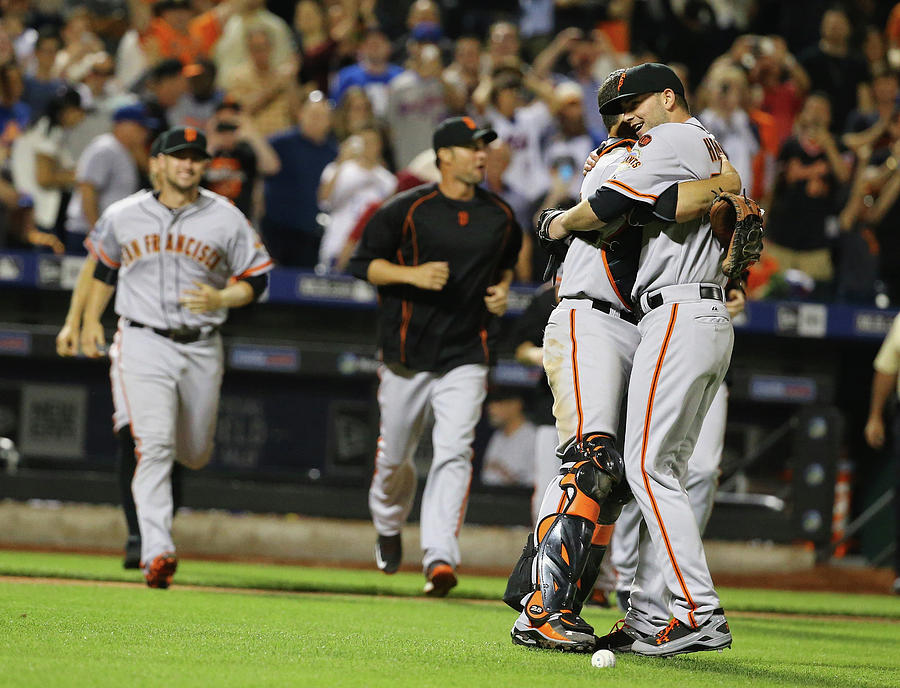 Chris Heston and Buster Posey Photograph by Al Bello