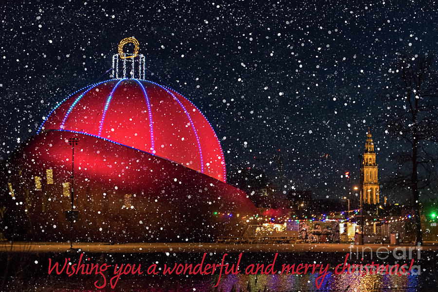 Christmas bauble building with snow in the Netherlands by Patricia Hofmeester
