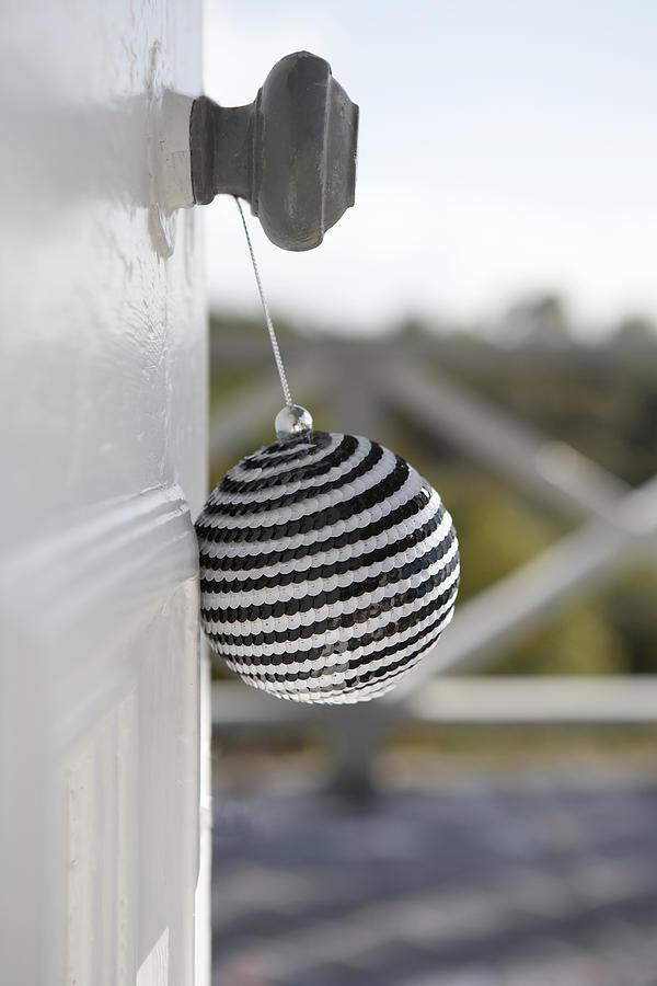 Christmas decoration on door handle Photograph by Heidi Coppock-Beard