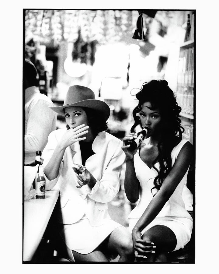 Christy Turlington and Naomi Campbell at the Central Grocery, New Orleans Photograph by Arthur Elgort