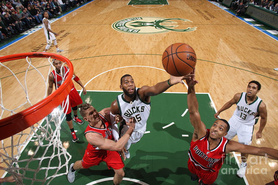 C.j. Mccollum and Greg Monroe Photograph by Gary Dineen