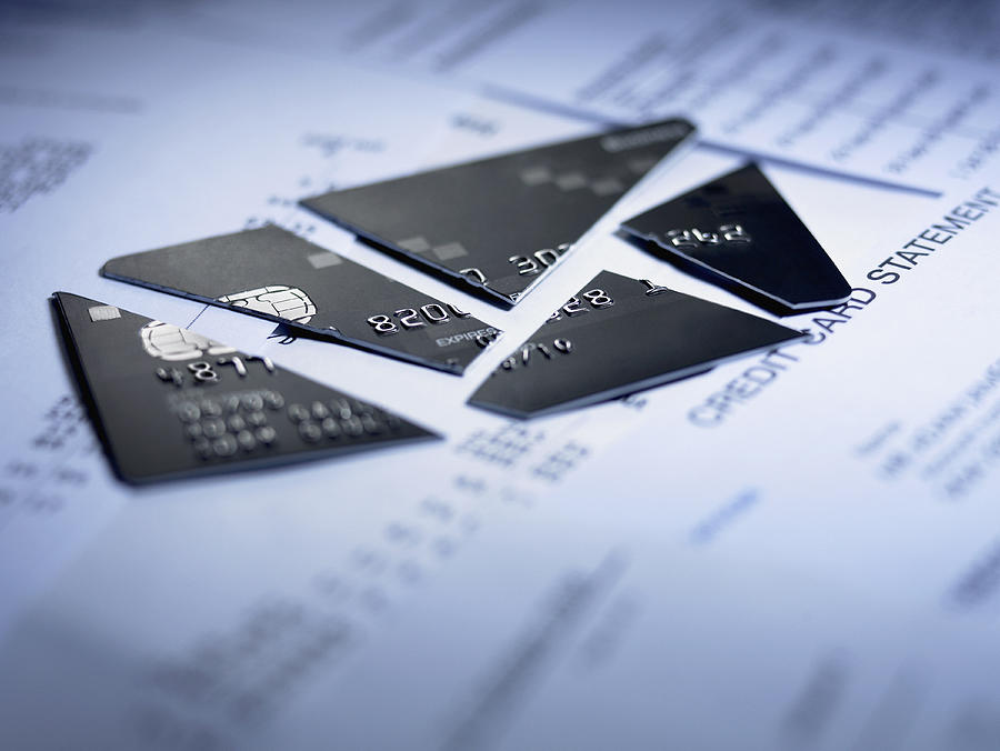 Close up of cut pieces of credit card Photograph by Adam Gault