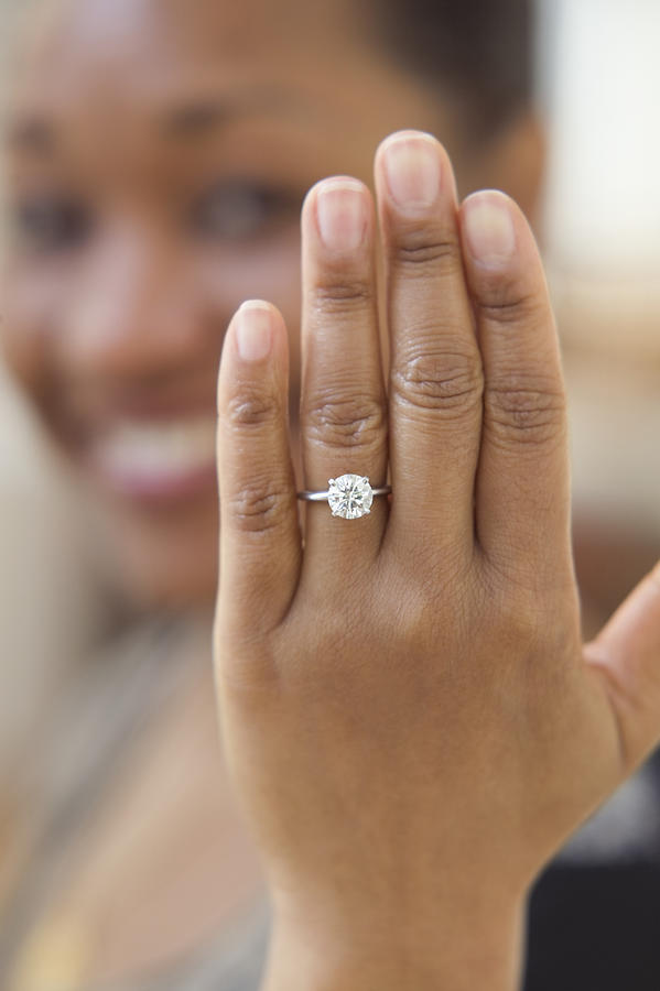 Close up of hand with engagement ring Photograph by Jose Luis Pelaez Inc