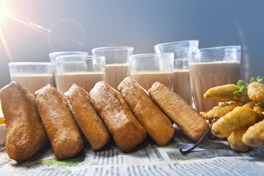 Close-up of pastry crust and chai for breakfast, DELHI, INDIA Photograph by Hemant Mehta